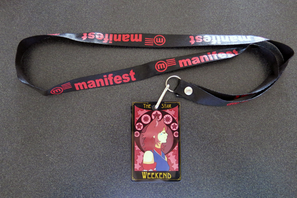 As per tradition, I've removed the lanyard it came with and instead attached my Manifest branded one.
