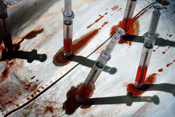 James the zombie guy's syringe riddled lab-coat is an appropriate addition to any project.