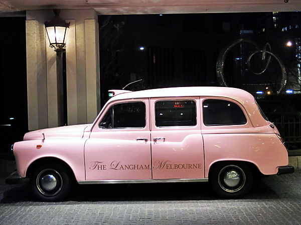 Langham Hotel's pink taxi.