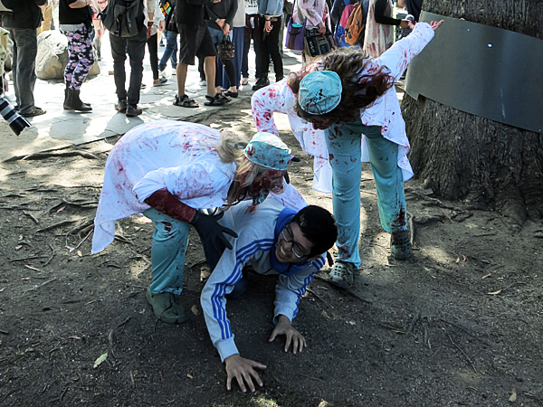 Zombie surgeons eating an innocent bystander.